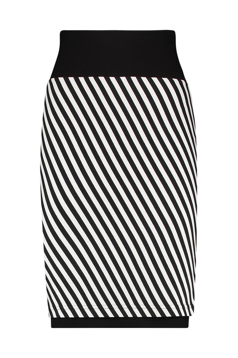 De Coco rev. is aan twee kanten draagbaar (omkeerbare rok) met dubbele tailleband om buik te corrigeren. De lengte is perfect tot de knie, u kunt de tailleband ook omslaan om de rok korter te maken. Materiaal: 95% viscose 5% elastaan